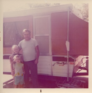 My sister and I with Dad on one of our many camping trips.