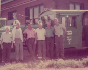 His railroad crew just outside the depot in my hometown. Dad is third from the right.